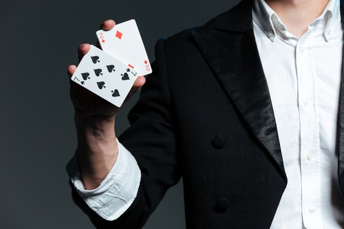 Magician with two cards